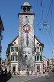 在教会的钟楼的绘画在日内瓦湖的沃韦市 库存图片