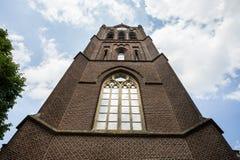 在教会,在的混杂的巴洛克式和佛兰芒意大利建筑风格建造的一个天主教会的门面的特写镜头细节 免版税库存照片