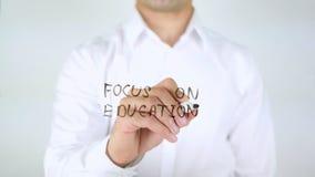在教育,在玻璃的人文字的焦点 库存照片