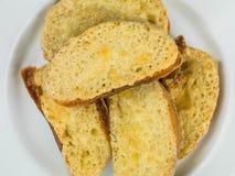 在敬酒的Ciabatta面包的热的熔化切达干酪 库存图片