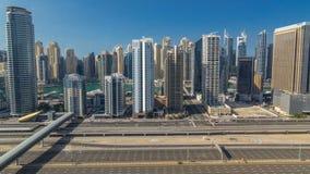 在整天期间的迪拜小游艇船坞摩天大楼空中顶视图从在迪拜timelapse的JLT,阿拉伯联合酋长国 股票视频