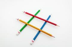 在文字的拳头力量的五颜六色的铅笔在白色的 库存图片