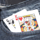在斜纹布口袋的卡片 图库摄影
