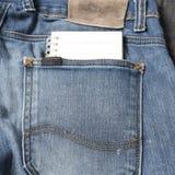在斜纹布口袋的笔记本纸 免版税图库摄影