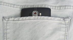 在斜纹布的巧妙的电话装在口袋里 免版税库存图片