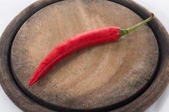 在斩肉板的红色辣椒 免版税图库摄影