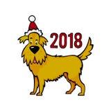 在新年` s盖帽的黄色土制狗 2018年的标志在 库存照片