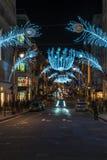 在新的政券街道上的圣诞灯 伦敦英国 免版税图库摄影