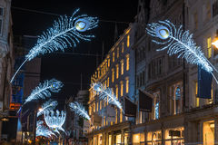 在新的政券街道,伦敦,英国上的圣诞灯 免版税库存照片