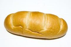 在新鲜的大面包上添面包 库存照片
