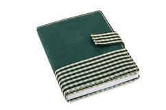 在方格的布料盖子的笔记薄有在白色的夹子的 免版税库存图片