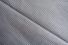 在方格的灰色织品的对角折痕 免版税库存图片