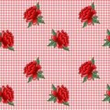 在方格的背景的刺绣玫瑰 库存照片
