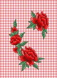 在方格的背景的刺绣玫瑰 免版税库存图片