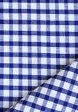 在方格的蓝色的洗碗布 免版税库存图片