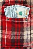 在方格的衬衣口袋的新的美元笔记 图库摄影