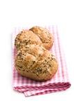 在方格的餐巾的面包 免版税库存图片