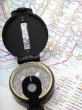 在旅行在日本的地图的指南针 免版税库存照片