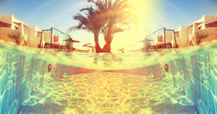在旅馆附近的热带水池 免版税图库摄影