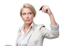 在无形的屏幕上的女实业家文字 免版税库存照片