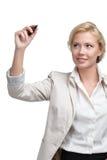 在无形的屏幕上的微笑的女商人文字 免版税库存图片