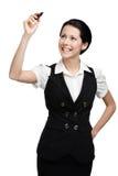 在无形的屏幕上的年轻企业夫人文字 免版税图库摄影