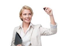 在无形的屏幕上的年轻女商人文字 免版税库存图片