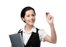 在无形的屏幕上的年轻女实业家文字 免版税库存照片