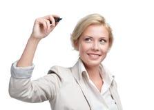 在无形的屏幕上的兴高采烈的女商人文字 免版税库存图片