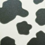在无缝的皮革的母牛印刷品 免版税库存照片