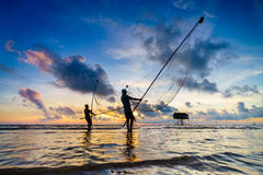 在日出期间的捕鱼网 免版税库存照片