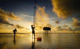 在日出期间的捕鱼网 免版税图库摄影