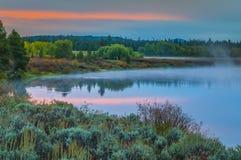 在日出的大提顿峰反射 库存图片