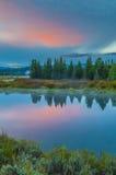 在日出的大提顿峰反射 图库摄影