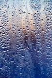 在日出的打旋的窗口作为背景 免版税库存照片