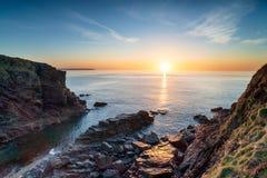 在日出的教会小海湾 免版税库存照片