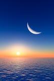 在日出的月亮 库存图片