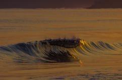 在日出的波浪 库存图片