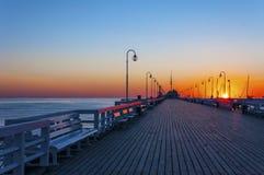 在日出的索波特码头 库存图片