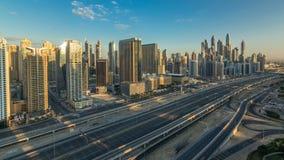 在日出的迪拜小游艇船坞摩天大楼空中顶视图从在迪拜timelapse的JLT,阿拉伯联合酋长国 影视素材