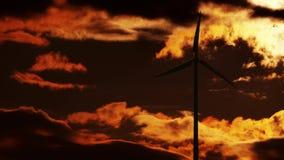 在日出的风轮机 库存照片