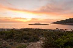 在日出的Cala de Sal rossa在伊维萨岛 库存图片
