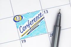 在日历的提示会议 免版税库存照片