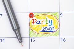 在日历的提示党与红色笔 库存图片