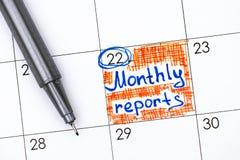 在日历的提示月度报告与笔 库存图片