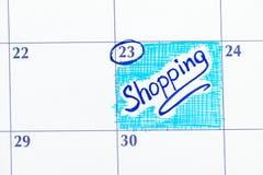 在日历的提示购物 库存图片