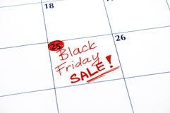 在日历的提示黑星期五销售 免版税库存照片