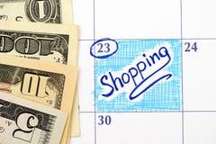 在日历的提示购物与美元 库存图片