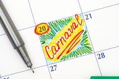 在日历的提示Carnaval与笔 免版税库存照片