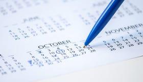 在日历的笔标记 库存照片